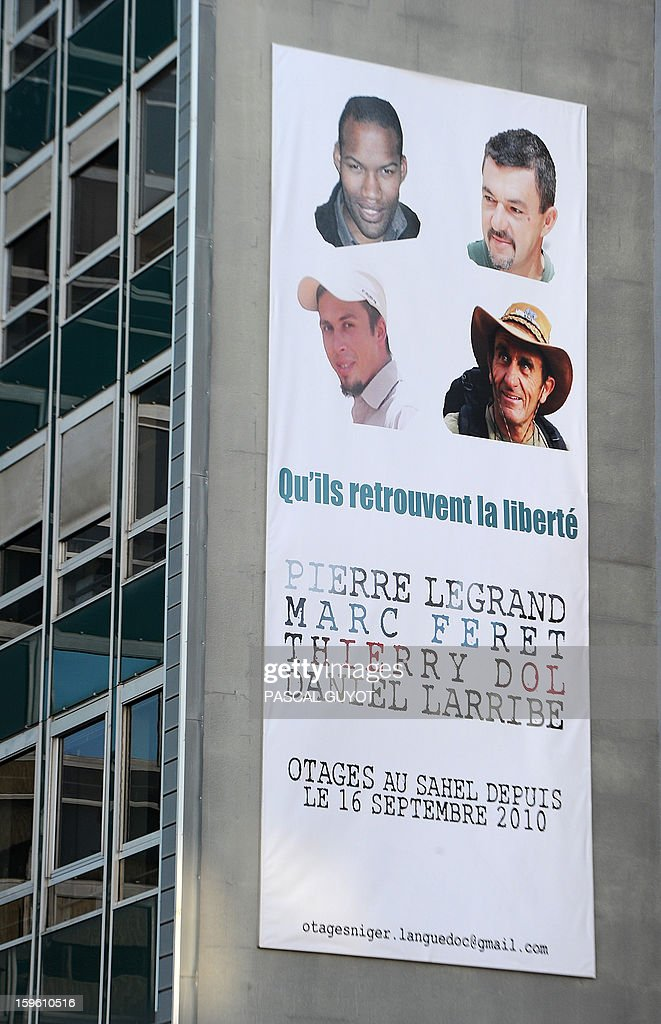 A close-up taken on January 17, 2013 in Nimes, southern France, shows the poster hung during a ceremony, on the facade of the General Council building in support to the four French hostages (LtoR, top to bottom: Thierry Dol, Marc Feret, Pierre Legrand and Daniel Larribe) captured in Niger and detained since 28 months in Mali by AQIM. The hostages were in a group of seven captured in Niger's uranium-mining town of Arlit. The 'Serval' French military operation backing Mali's army in battling Islamist insurgents currently has some 1,400 soldiers deployed, some of whom are engaged in ground operations.