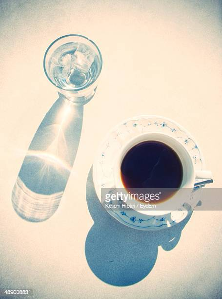 Close-up top view of coffee with glass of water
