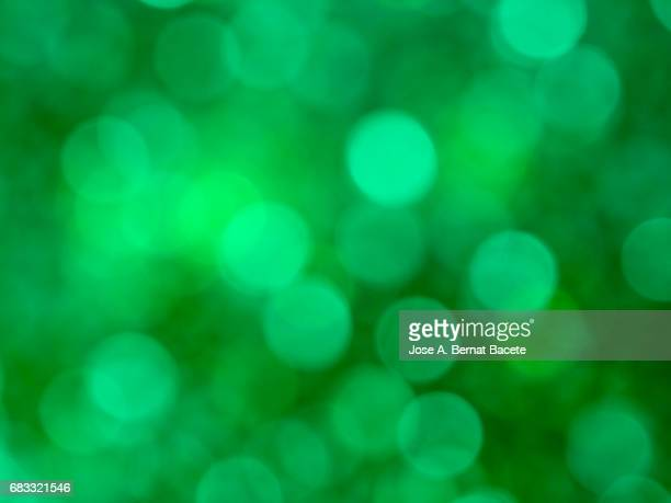 Close-up unfocused lights in the shape of circles of  green background