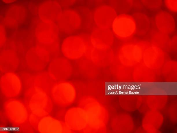 Close-up unfocused lights in the shape of circles of red and orange background