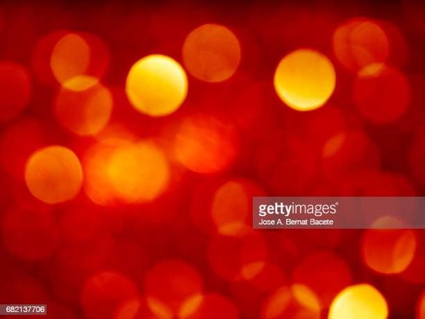 Close-up unfocused lights in the shape of circles of  red background