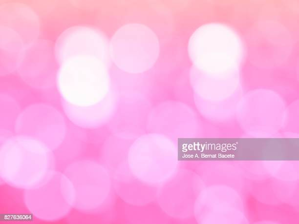 Close-up unfocused lights in the shape of circles of vintage pink background