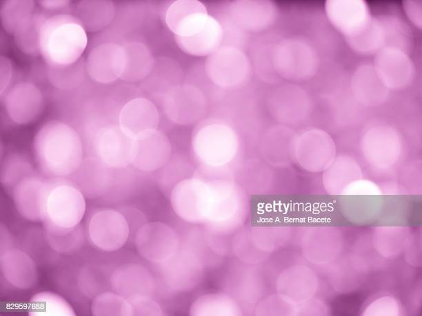 Close-up unfocused lights in the shape of circles of vintage purple background