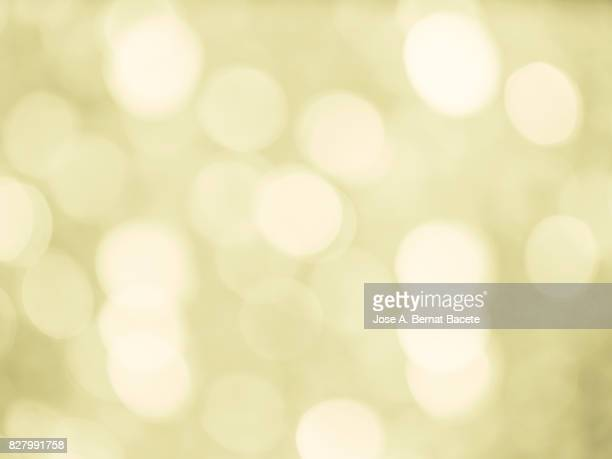 Close-up unfocused lights in the shape of circles of vintage yellow background