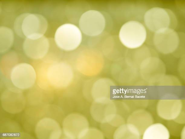 Close-up unfocused lights in the shape of circles of  yellow background
