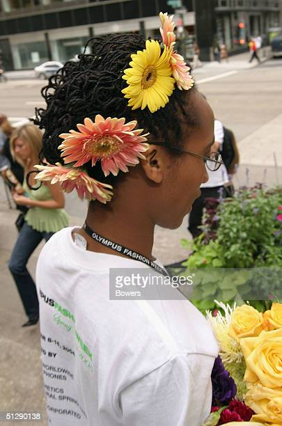 A closeup view is shown flowers in a girl's hair during the Olympus Fashion Week Spring 2005 at Bryant Park September 11 2004 in New York City
