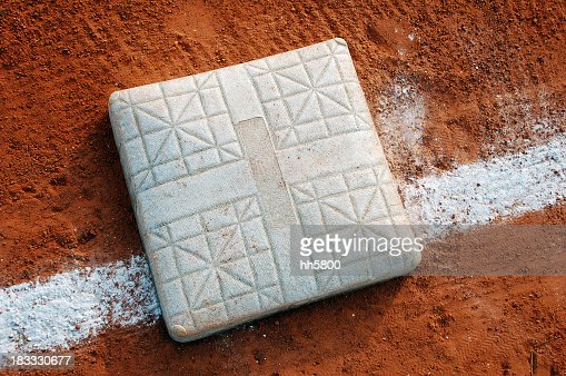 Close-up view of a baseball base on the field