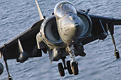 Persian, Gulf, March 12, 2008 - An AV-8B Harrier assigned to Marine Medium Helicopter Squadron Reinforced (HMM)166 (REIN) lands on the flight deck of the amphibious assault ship USS Tarawa (LHA 1).
