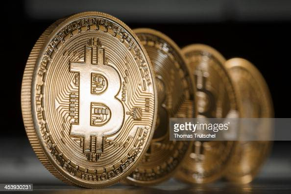 A closeup view of an illustration model of a Bitcoin is seen on December 6 2013 in Berlin Germany Central bankers around the world have warned about...