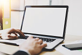 Closeup view of banking finance analyst working at sunny office on laptop.Blurred,horizontal mockup