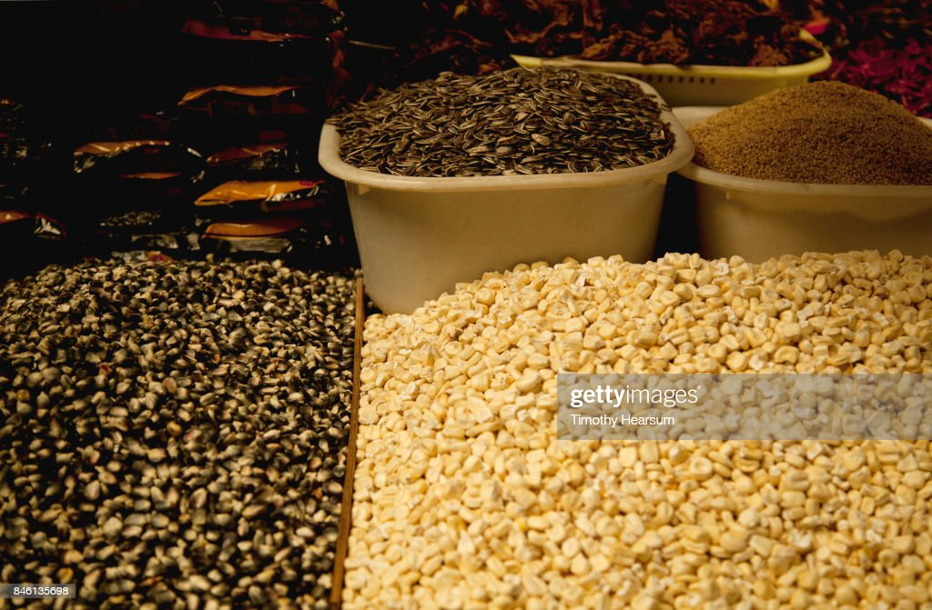 Close-up view of bins of dried corn, sunflower seeds and chilis : Stock Photo