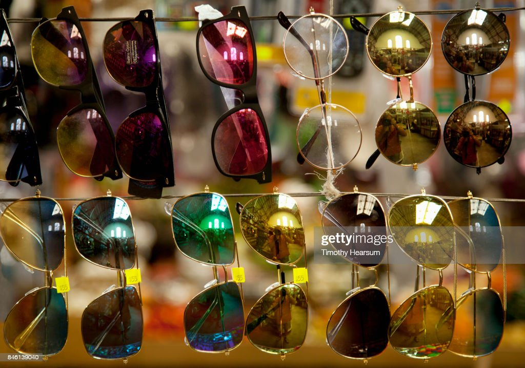 Close-up view of display of sunglasses at a market : Stock Photo