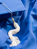 Close-up view of graduation gown