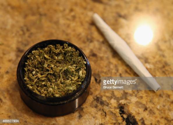 A closeup view of marijuana in a grinder along with a cigarette as photographed on August 30 2014 in Bethpage New York