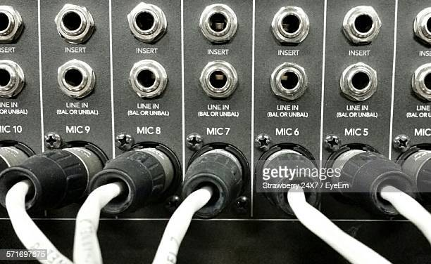 Close-Up View Of Microphone Plugs In Sound Mixer