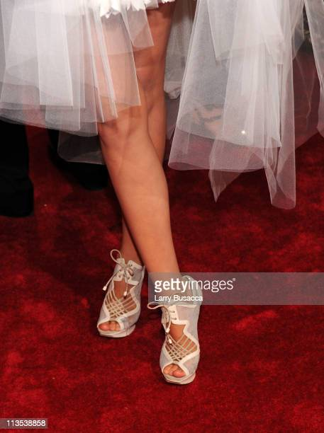 A closeup view of model Miranda Kerr's shoes at the 'Alexander McQueen Savage Beauty' Costume Institute Gala at The Metropolitan Museum of Art on May...