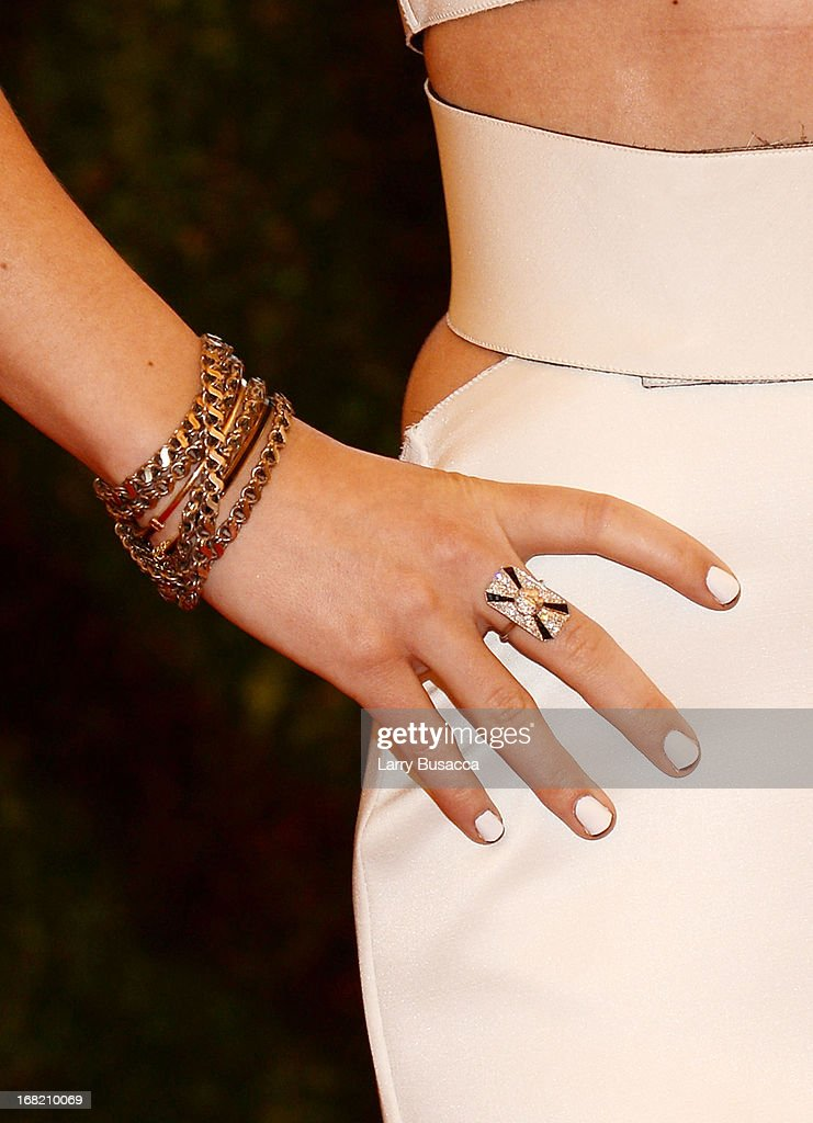 Close-up view of Olivia Wilde's bracelets at the Costume Institute Gala for the 'PUNK: Chaos to Couture' exhibition at the Metropolitan Museum of Art on May 6, 2013 in New York City.