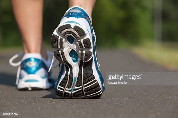 Close-up view of sports shoes in mid stride