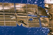 A closeup view of the solar array panel on Russia's Mir Space Station's shows damage incurred by the impact of a Russian unmanned Progress resupply...