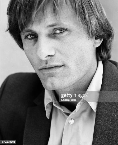 Closeup view of Viggo Mortensen dressed in a buttondown shirt and sport coat he looks directly into the lens during a photo session on April 13 1997...