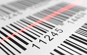 Close-up view on red laser is scanning label with barcode on product. 3D rendered illustration.