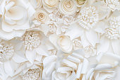 Closeup white paper flower design background, beautiful flower background