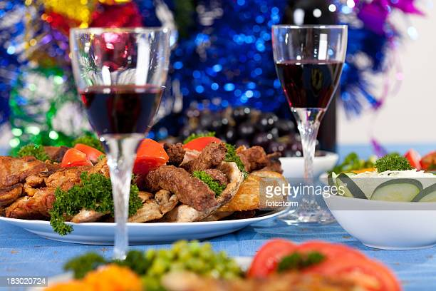 Close-up wine and food on the table with Christmas decoration