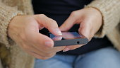 Close-up woman hands using smartphone - scrolling and touching