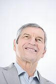 closeup.confident senior businessman looking up at copy space .photo with copy space