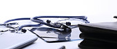 closeup.stethoscope at the workplace of the doctor.the concept of health