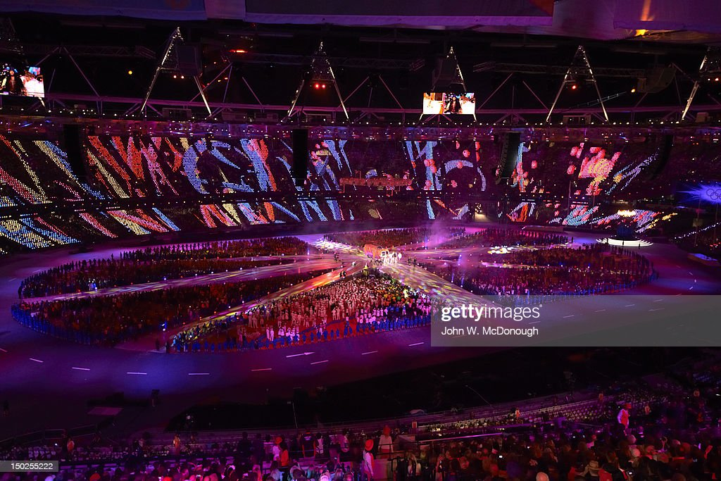 Overall view of celebrity comedian Russell Brand singing cover of The Beatles 'I Am the Walrus' with Bond during performance at Olympic Stadium. John W. McDonough F40 )
