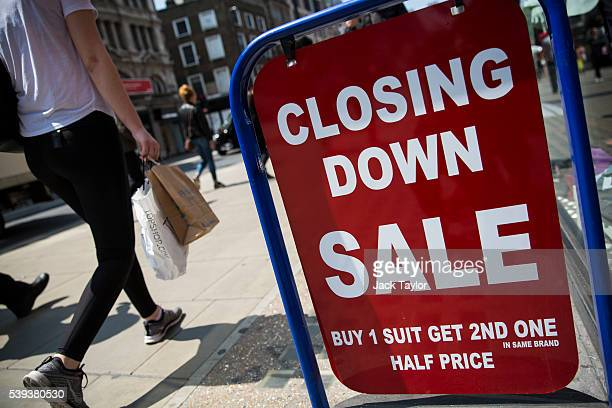 A closing down sale sign is seen outside a men's clothing shop on Oxford Street on June 9 2016 in London England Conditions are tough for the High...