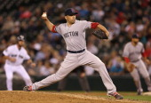 Closing pitcher Alfredo Aceves of the Boston Red Sox pitches in the eighth inning against the Seattle Mariners at Safeco Field on September 5 2012 in...