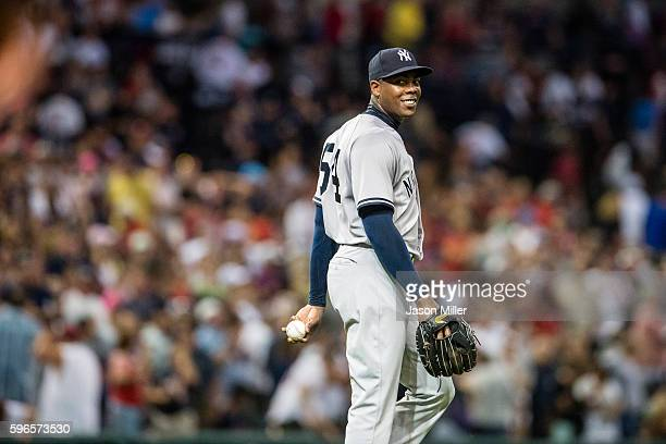 Closing pitcher Aroldis Chapman of the New York Yankees reacts after umpires call the last out after a review to give the Yankees the 54 win over...