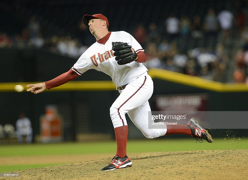 Closing pitcher <a gi-track='captionPersonalityLinkClicked' href=/galleries/search?phrase=Brad+Ziegler&family=editorial&specificpeople=4921772 ng-click='$event.stopPropagation()'>Brad Ziegler</a> #29 of the Arizona Diamondbacks pitches against the Tampa Bay Rays in the ninth inning at Chase Field on August 6, 2013 in Phoenix, Arizona. The Diamondbacks defeated the Rays 6-1.