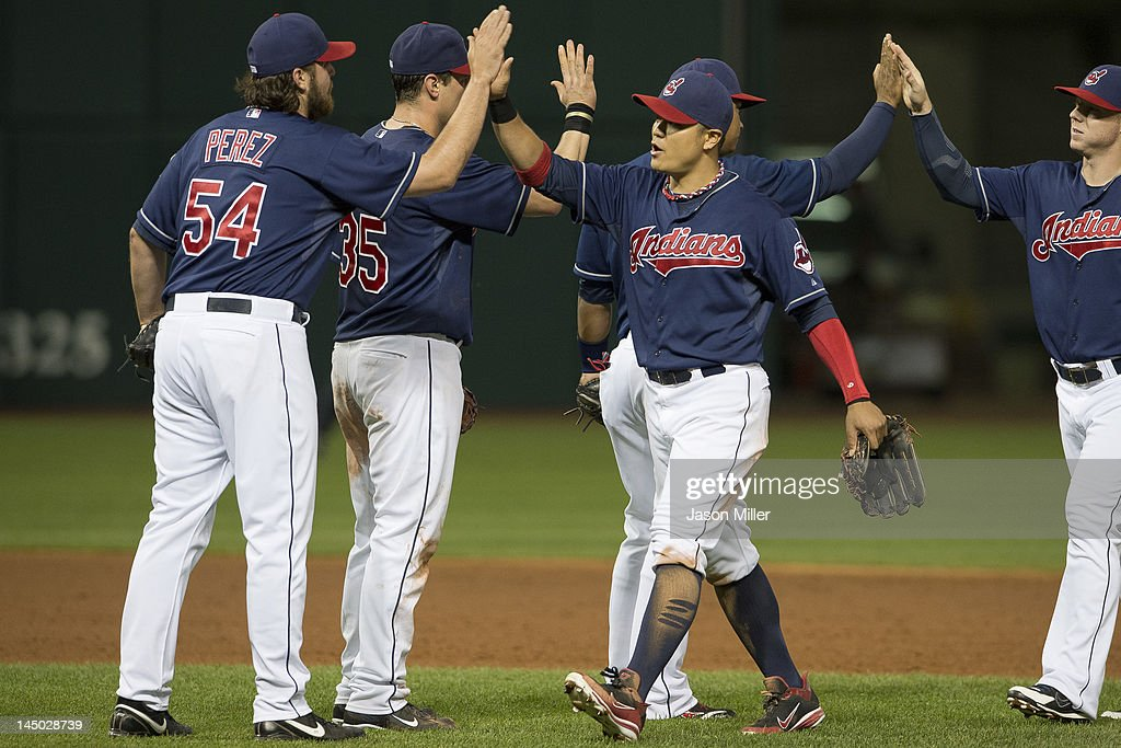 Closing pitcher Chris Perez #54 celebrates with <a gi-track='captionPersonalityLinkClicked' href=/galleries/search?phrase=Shin-Soo+Choo&family=editorial&specificpeople=196543 ng-click='$event.stopPropagation()'>Shin-Soo Choo</a> #17 of the Cleveland Indians after the Indians defeated the against the Detroit Tigers at Progressive Field on May 22, 2012 in Cleveland, Ohio. The Indians defeated the Tigers 5-3.