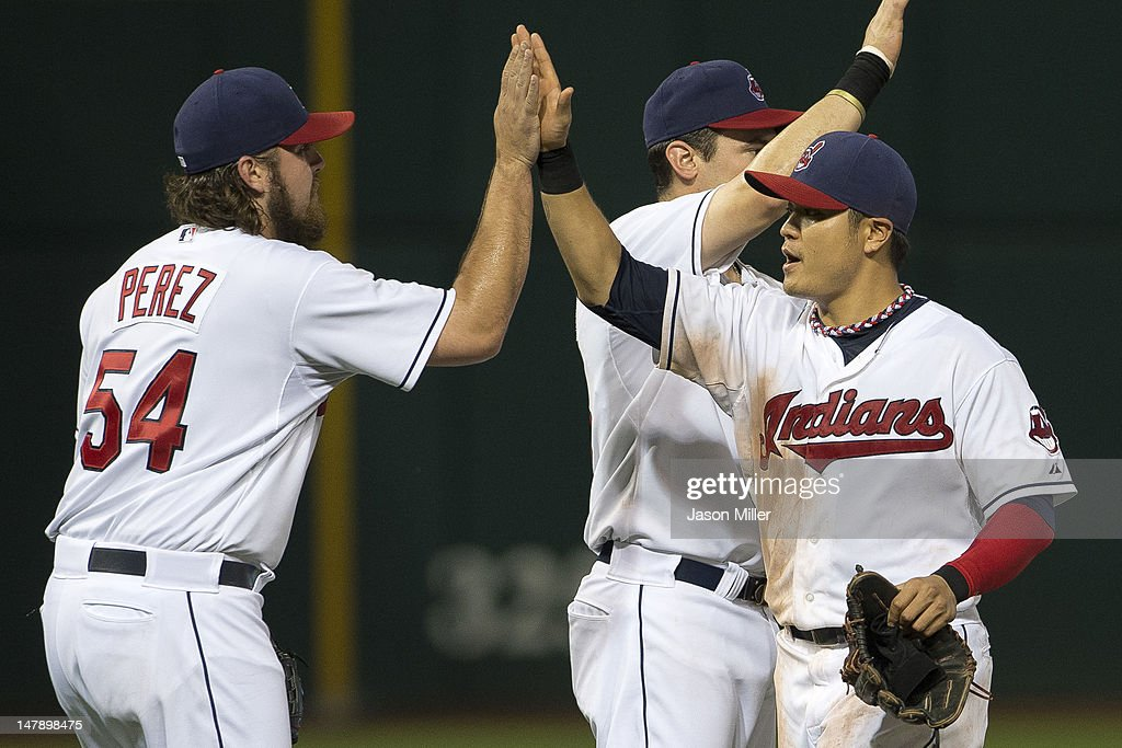 Closing pitcher Chris Perez #54 celebrates with <a gi-track='captionPersonalityLinkClicked' href=/galleries/search?phrase=Shin-Soo+Choo&family=editorial&specificpeople=196543 ng-click='$event.stopPropagation()'>Shin-Soo Choo</a> #17 of the Cleveland Indians after the Indians defeated the Tampa Bay Rays at Progressive Field on July 5, 2012 in Cleveland, Ohio. The Indians defeated the Rays 3-1.