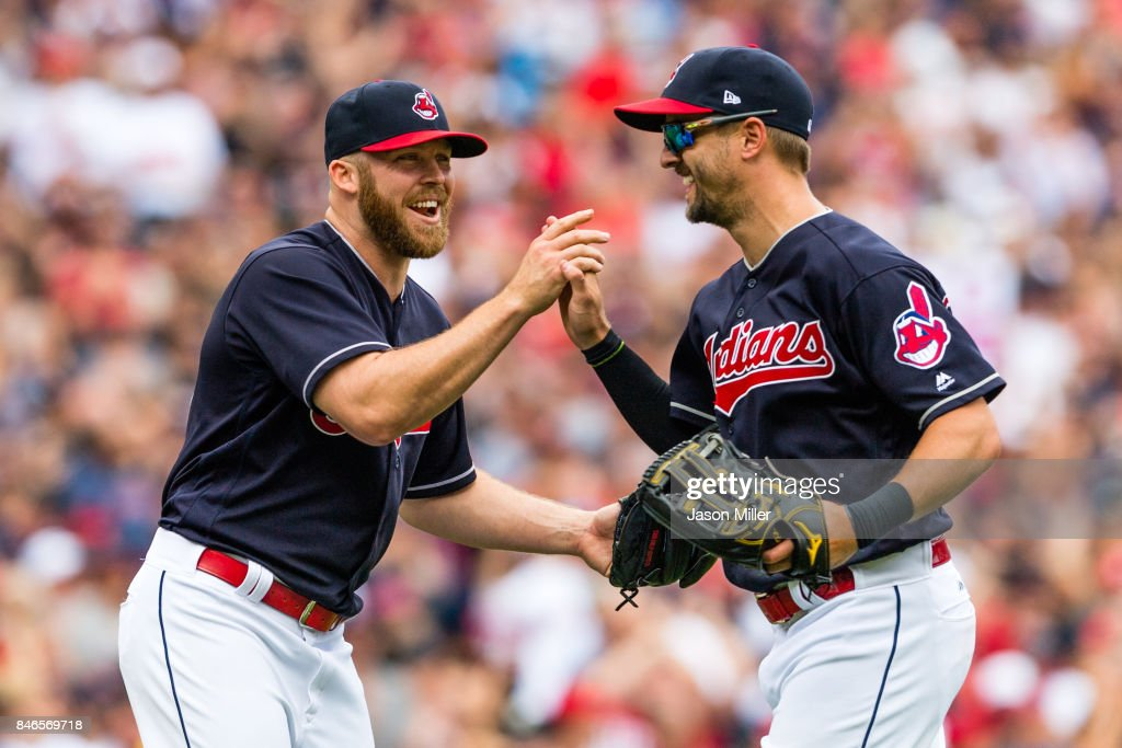 Closing pitcher Cody Allen #37 celebrates with left fielder Lonnie Chisenhall #8 of the Cleveland Indians who made the final catch to defeat the Detroit Tigers at Progressive Field on September 13, 2017 in Cleveland, Ohio. The Indians defeated the Tigers to win 21 straight games.