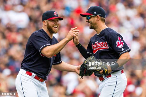 Closing pitcher Cody Allen celebrates with left fielder Lonnie Chisenhall of the Cleveland Indians who made the final catch to defeat the Detroit...