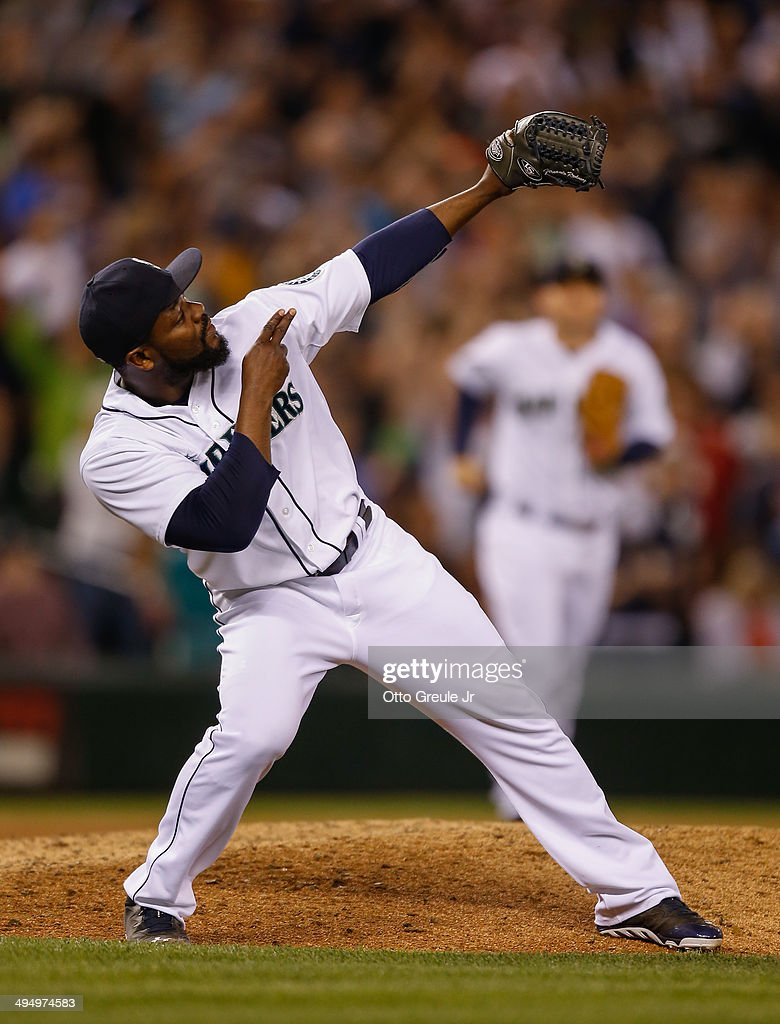 Closing pitcher <a gi-track='captionPersonalityLinkClicked' href=/galleries/search?phrase=Fernando+Rodney&family=editorial&specificpeople=547291 ng-click='$event.stopPropagation()'>Fernando Rodney</a> #56 of the Seattle Mariners celebrates after defeating the Detroit Tigers 3-2 at Safeco Field on May 31, 2014 in Seattle, Washington.