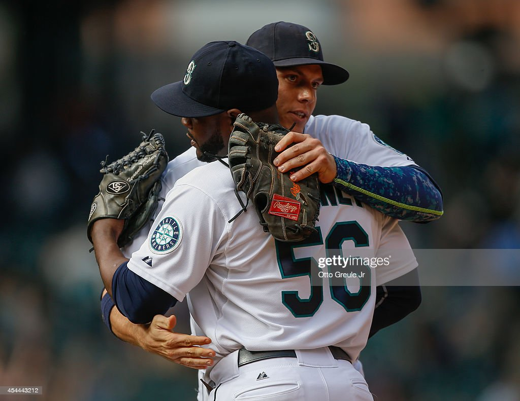 Closing pitcher <a gi-track='captionPersonalityLinkClicked' href=/galleries/search?phrase=Fernando+Rodney&family=editorial&specificpeople=547291 ng-click='$event.stopPropagation()'>Fernando Rodney</a> #56 of the Seattle Mariners is congratulated by <a gi-track='captionPersonalityLinkClicked' href=/galleries/search?phrase=Logan+Morrison&family=editorial&specificpeople=5690834 ng-click='$event.stopPropagation()'>Logan Morrison</a> #20 after a 5-3 win over the Washington Nationals at Safeco Field on August 31, 2014 in Seattle, Washington.