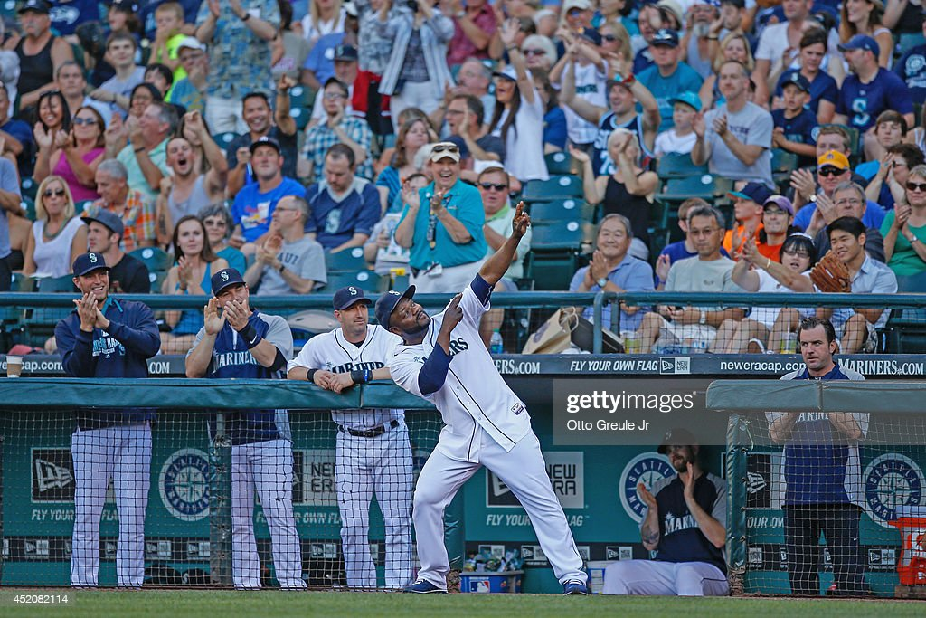 Closing pitcher <a gi-track='captionPersonalityLinkClicked' href=/galleries/search?phrase=Fernando+Rodney&family=editorial&specificpeople=547291 ng-click='$event.stopPropagation()'>Fernando Rodney</a> #56 of the Seattle Mariners strikes his archer's pose after it was announced he had been selected to the Allstar Game in the first inning against the Oakland Athletics at Safeco Field on July 12, 2014 in Seattle, Washington.