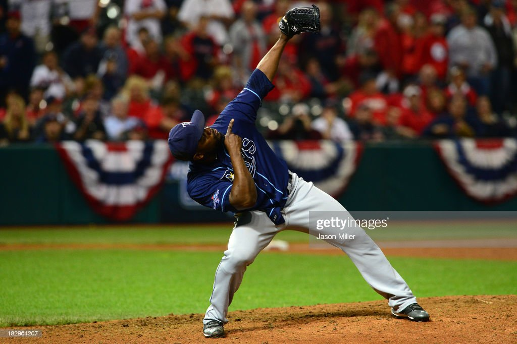 Closing pitcher <a gi-track='captionPersonalityLinkClicked' href=/galleries/search?phrase=Fernando+Rodney&family=editorial&specificpeople=547291 ng-click='$event.stopPropagation()'>Fernando Rodney</a> #56 of the Tampa Bay Rays celebrates after the Rays defeated the Cleveland Indians at Progressive Field on October 2, 2013 in Cleveland, Ohio.
