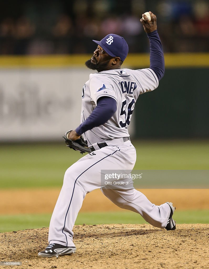 Closing pitcher <a gi-track='captionPersonalityLinkClicked' href=/galleries/search?phrase=Fernando+Rodney&family=editorial&specificpeople=547291 ng-click='$event.stopPropagation()'>Fernando Rodney</a> #56 of the Tampa Bay Rays pitches against the Seattle Mariners at Safeco Field on August 13, 2012 in Seattle, Washington. The Rays defeated the Mariners 4-1.