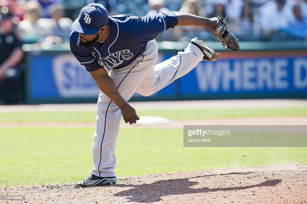 Closing pitcher <a gi-track='captionPersonalityLinkClicked' href=/galleries/search?phrase=Fernando+Rodney&family=editorial&specificpeople=547291 ng-click='$event.stopPropagation()'>Fernando Rodney</a> #56 of the Tampa Bay Rays pitches during the ninth inning against the Cleveland Indians of the Tampa Bay Rays at Progressive Field on July 8, 2012 in Cleveland, Ohio. The Rays defeated the Indians 7-6.
