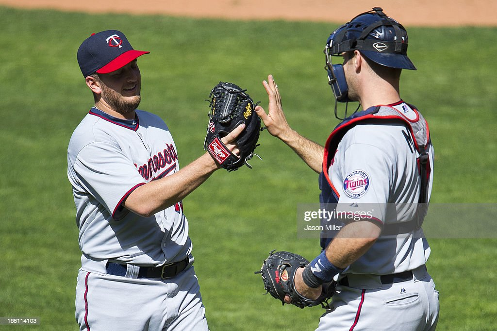Closing pitcher <a gi-track='captionPersonalityLinkClicked' href=/galleries/search?phrase=Glen+Perkins&family=editorial&specificpeople=835845 ng-click='$event.stopPropagation()'>Glen Perkins</a> #15 celebrates with catcher <a gi-track='captionPersonalityLinkClicked' href=/galleries/search?phrase=Joe+Mauer&family=editorial&specificpeople=214614 ng-click='$event.stopPropagation()'>Joe Mauer</a> #7 of the Minnesota Twins after the Twins defeated the Cleveland Indians at Progressive Field on May 5, 2013 in Cleveland, Ohio. The Twins defeated the Indians 4-2.