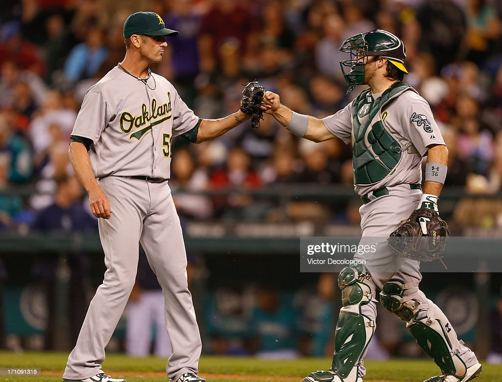 Closing pitcher <a gi-track='captionPersonalityLinkClicked' href=/galleries/search?phrase=Grant+Balfour&family=editorial&specificpeople=833980 ng-click='$event.stopPropagation()'>Grant Balfour</a> #50 of the Oakland Athletics is congratulated by catcher <a gi-track='captionPersonalityLinkClicked' href=/galleries/search?phrase=Derek+Norris&family=editorial&specificpeople=6795804 ng-click='$event.stopPropagation()'>Derek Norris</a> #36 after a win over the Seattle Mariners 6-3 at Safeco Field on June 21, 2013 in Seattle, Washington.