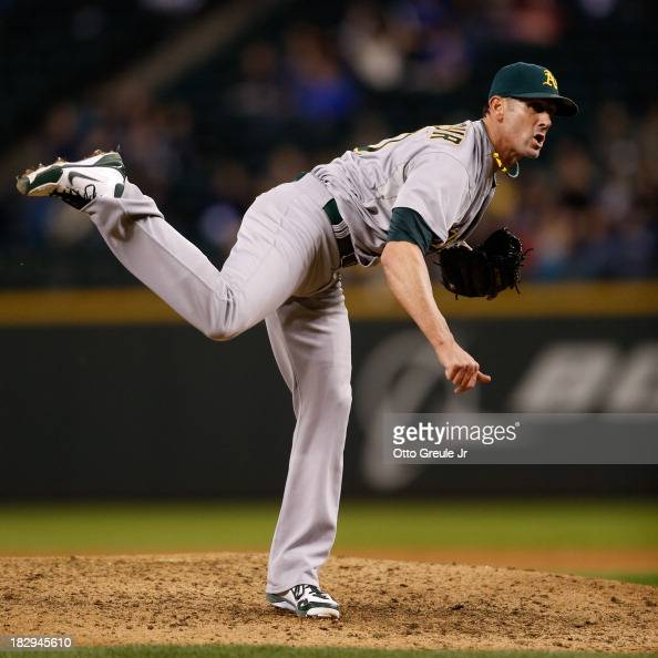 Closing pitcher Grant Balfour of the Oakland Athletics pitches in the ninth inning against the Seattle Mariners at Safeco Field on September 27 2013...