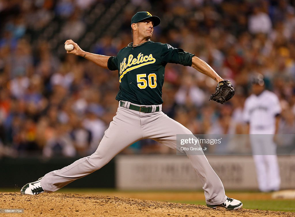 Closing pitcher <a gi-track='captionPersonalityLinkClicked' href=/galleries/search?phrase=Grant+Balfour&family=editorial&specificpeople=833980 ng-click='$event.stopPropagation()'>Grant Balfour</a> #50 of the Oakland Athletics pitches against the Seattle Mariners at Safeco Field on May 11, 2013 in Seattle, Washington. The Athletics defeated the Mariners 4-3.