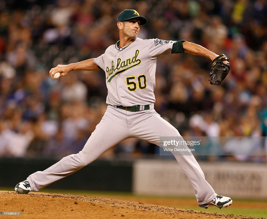 Closing pitcher <a gi-track='captionPersonalityLinkClicked' href=/galleries/search?phrase=Grant+Balfour&family=editorial&specificpeople=833980 ng-click='$event.stopPropagation()'>Grant Balfour</a> #50 of the Oakland Athletics pitches against the Seattle Mariners at Safeco Field on June 21, 2013 in Seattle, Washington. The Athletics defeated the Mariners 6-3.